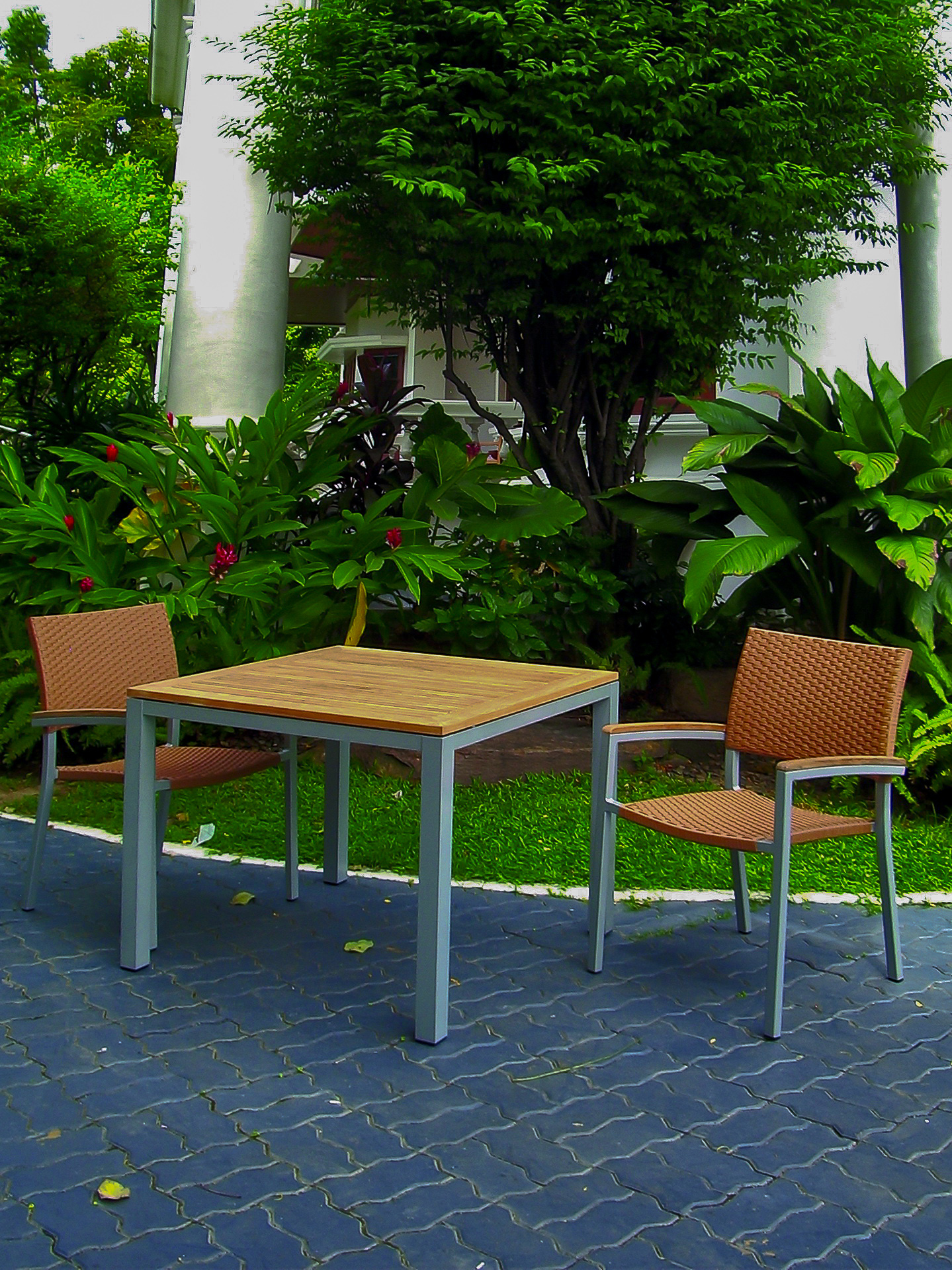 Core Teak and Powder Coated Aluminum 4 top table and matching wicker Ultimate Chair copy.jpg