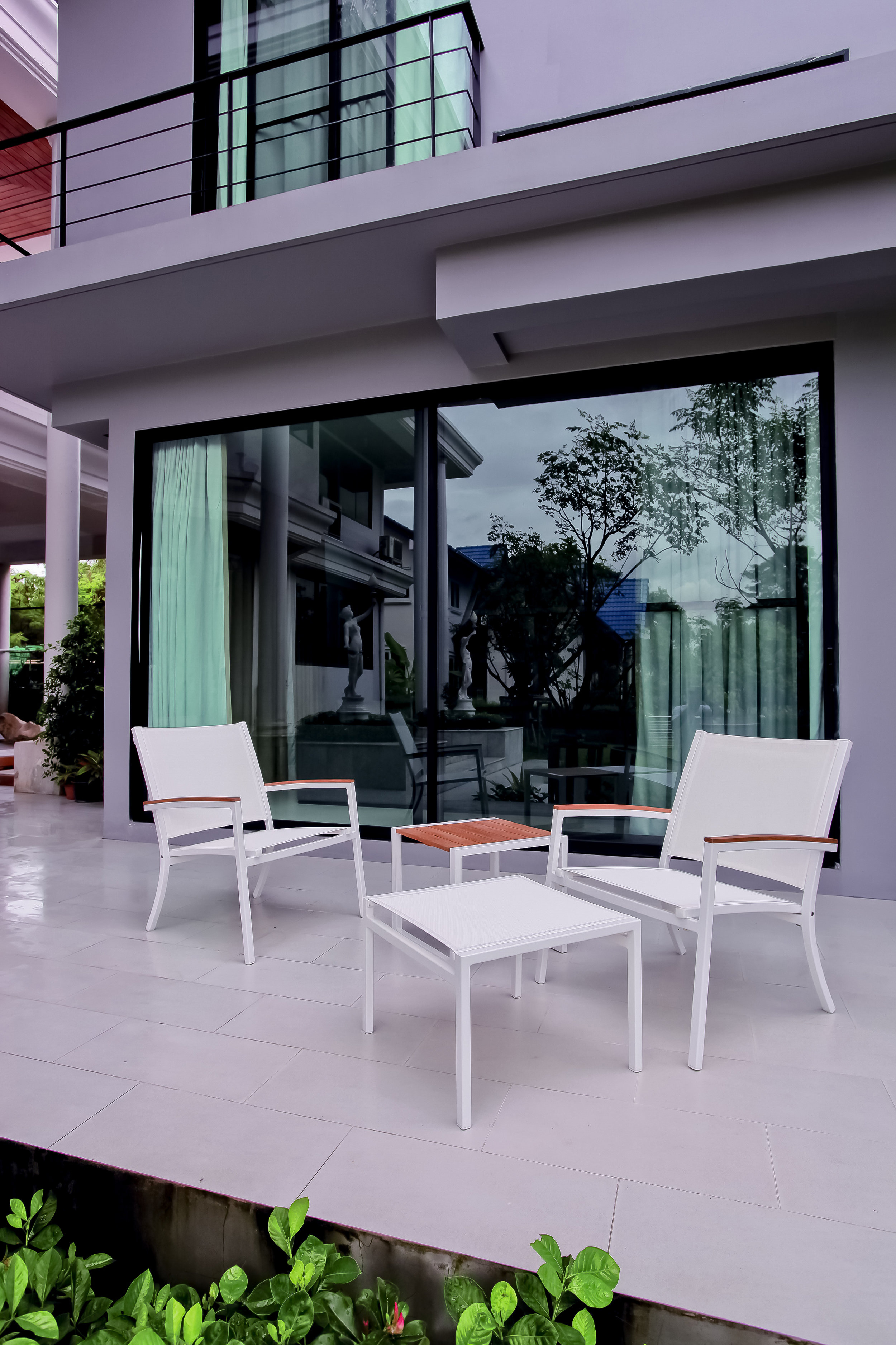 Core Wide ultimate Powder Coated chair with ottomanand matching teak side table copy.jpg