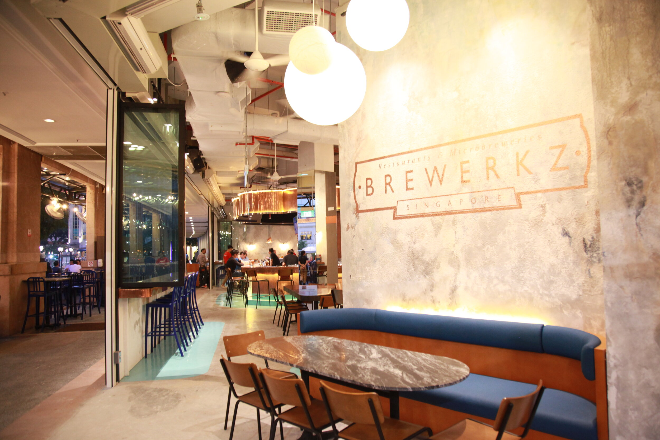 Brewerkz Riverside Point - A local mural artist creates an aged lived-in effect reminiscent of an inviting hall.JPG