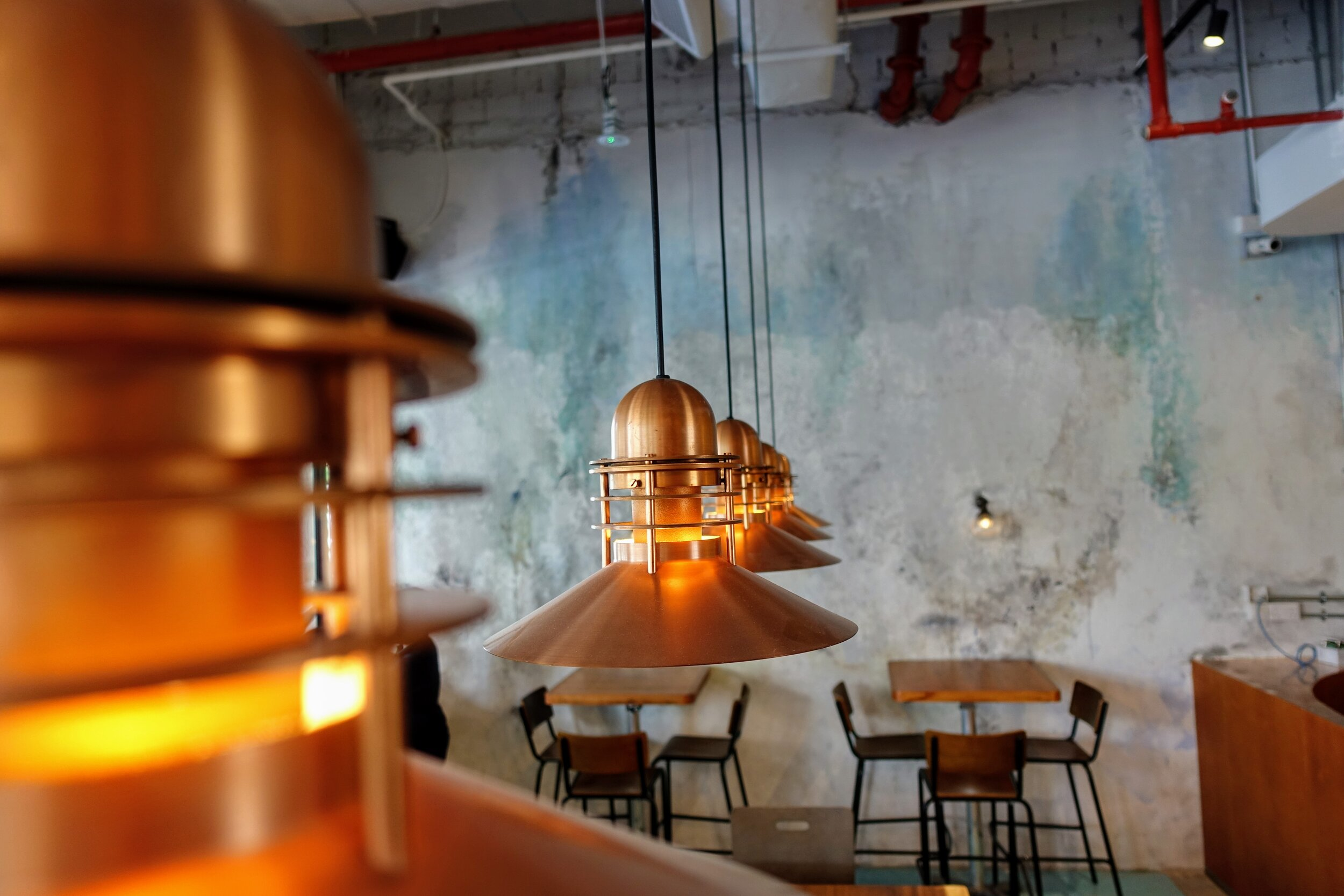 Brewerkz Riverside Point - Copper lights inspired by traditional beer making equipment and the modern beer can.JPG