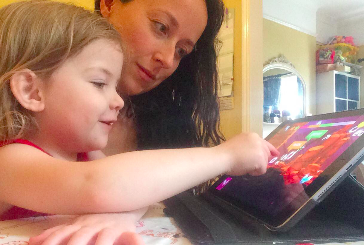 Four-year-old Annabelle playing Poio while her mother Vicky is watching her progress. Photo: Private.