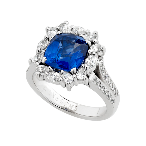 3ct Cushion cut Ceylon Sapphire set in a multi shape Diamond Cluster