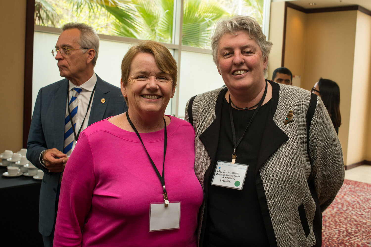 Alison Verhoeven from Australian Healthcare and Hospitals Association (left), Jo Watson from Consumer Health Forum (right), and Andreas Loefler, Australian Orthopaedic Association Past President (background)
