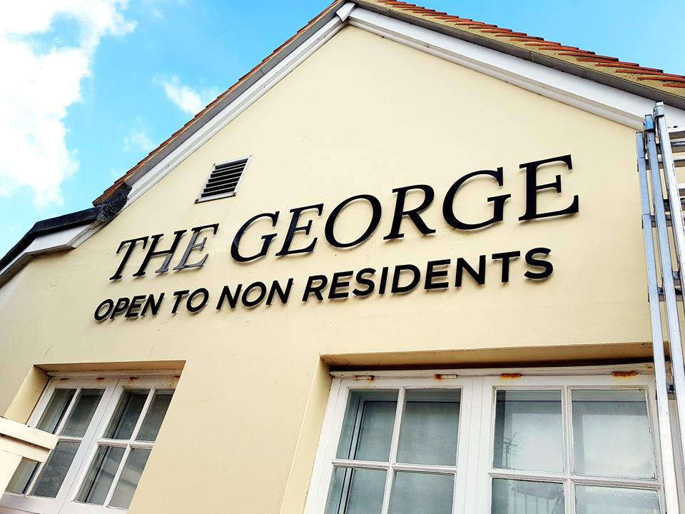 The George Hotel wall sign