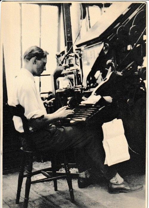 Paul Beardsall working on a letterpress