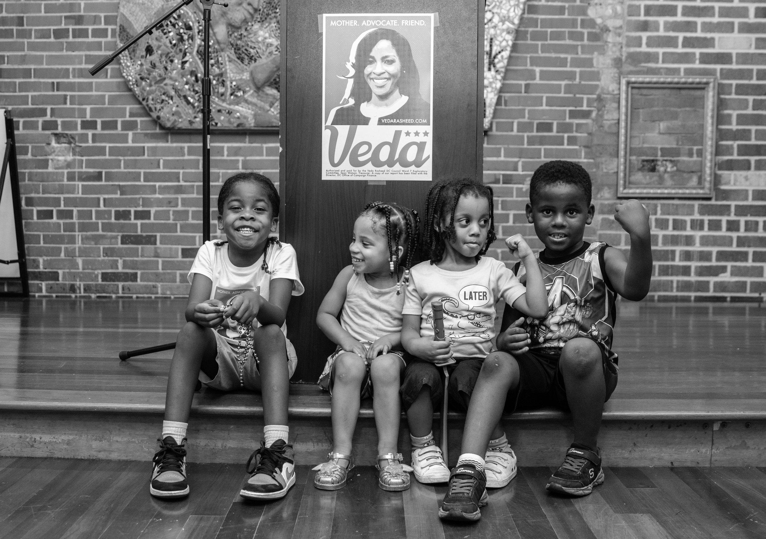 kids at podium white and black.jpg