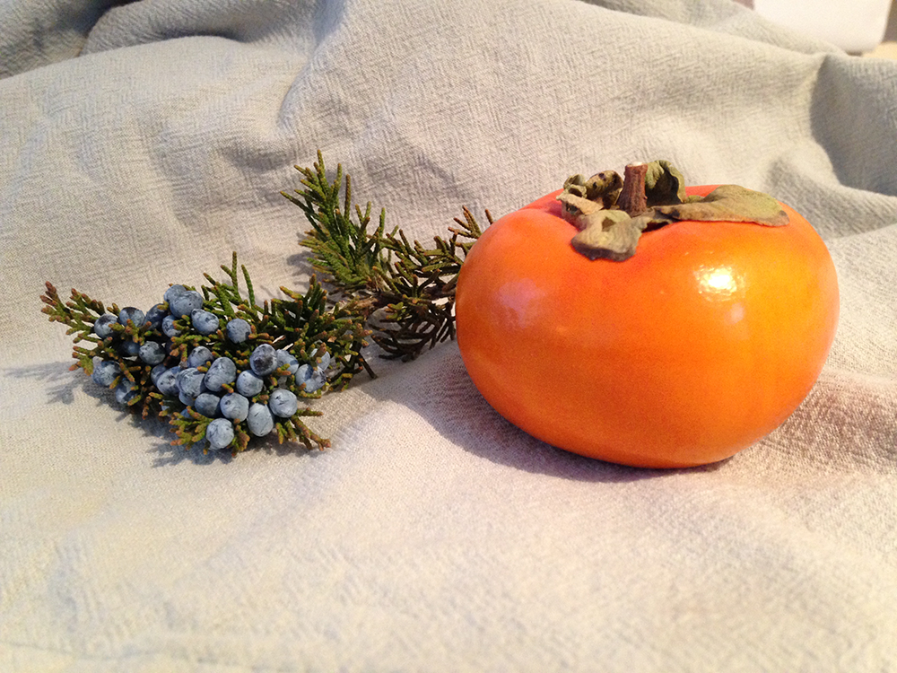 To celebrate the seasons of both coasts, I've chosen a persimmon and a sprig of juniper.