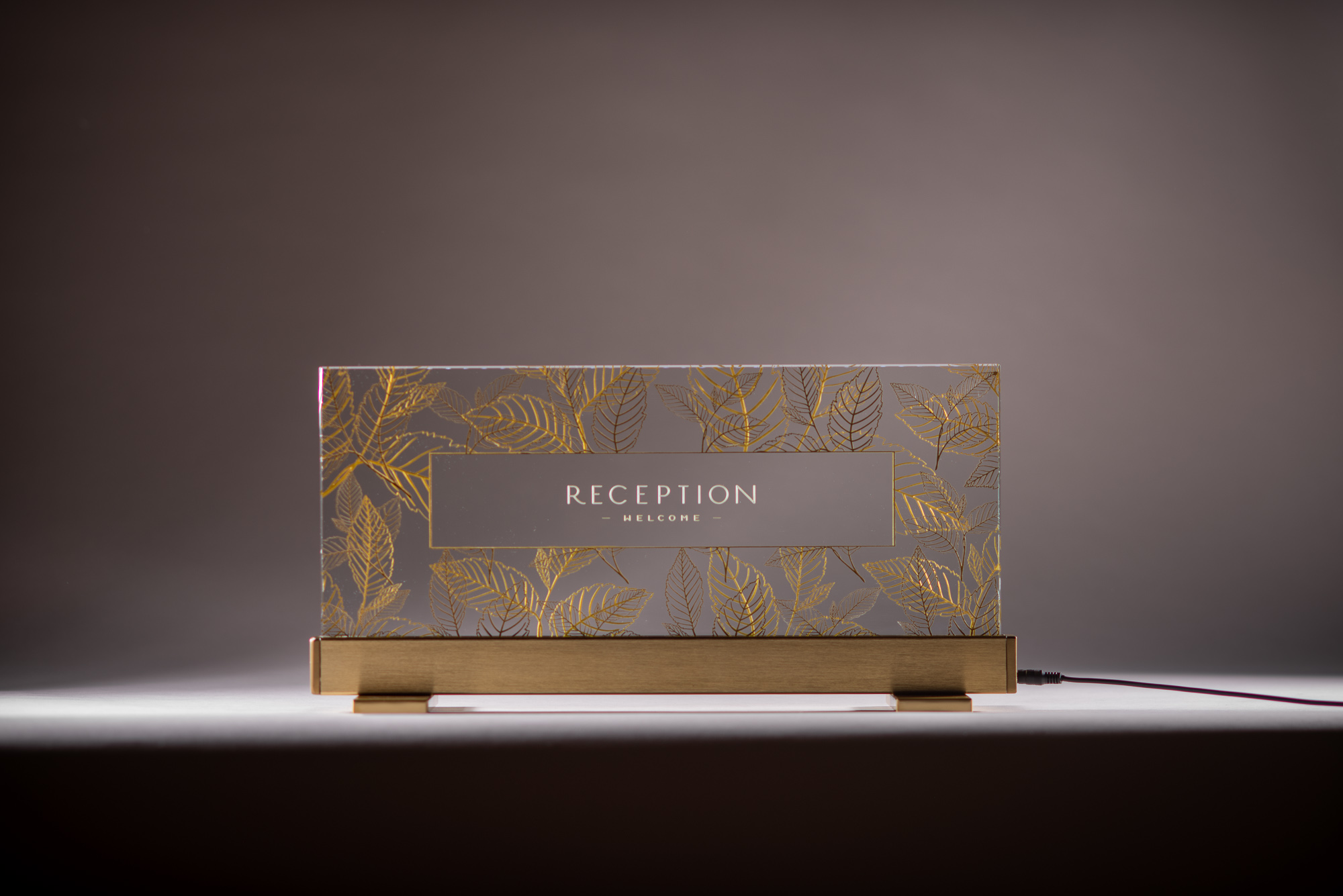 Reception Sign - Etched and carved glass, monument-gold paint fill.