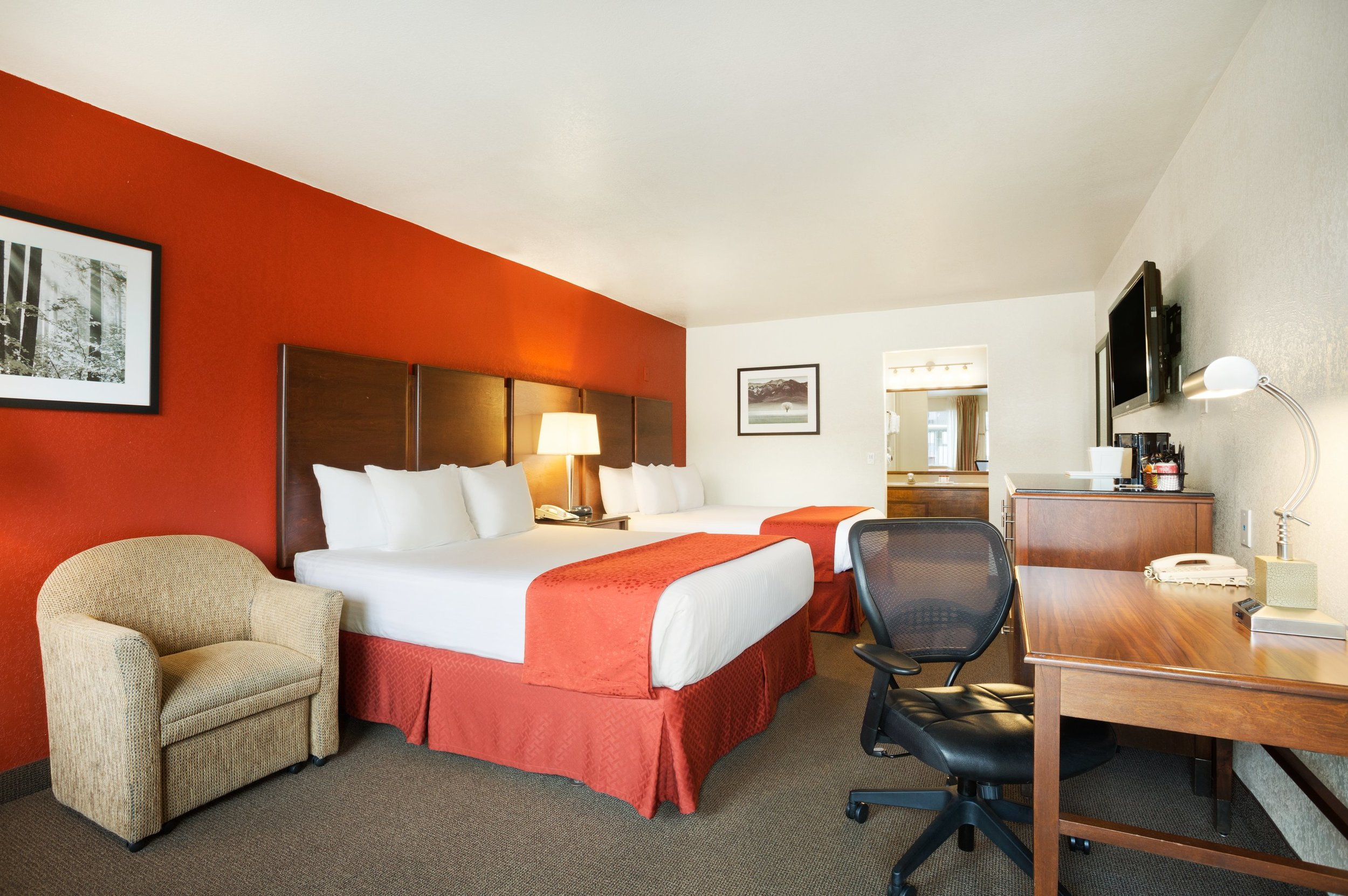 Business class two queen - For guests in search of a little extra space to spread out and make themselves at home, look no further than our Business Class Two Queen Room. With all of the comforts of our Standard Two Queen Room, this elevated guest room features an activity area with lounge chairs.Max 4 Guests 2 Queen Beds