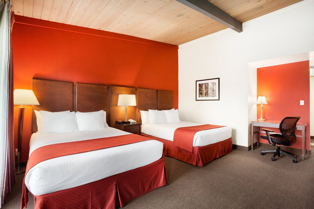 Our Refreshing Accommodations - Take in beautiful views of our property in one of our Courtyard Rooms! These hotel rooms in San Diego come equipped with two queen beds, perfect for a group getaway, or a single king, ideal for a romantic getaway! Guests traveling to the area on business will enjoy a night's stay in our Business Class Two Queen Room, which gives guests a little bit more space during their San Diego work trip.Click here to take a virtual tour of our business class guest rooms
