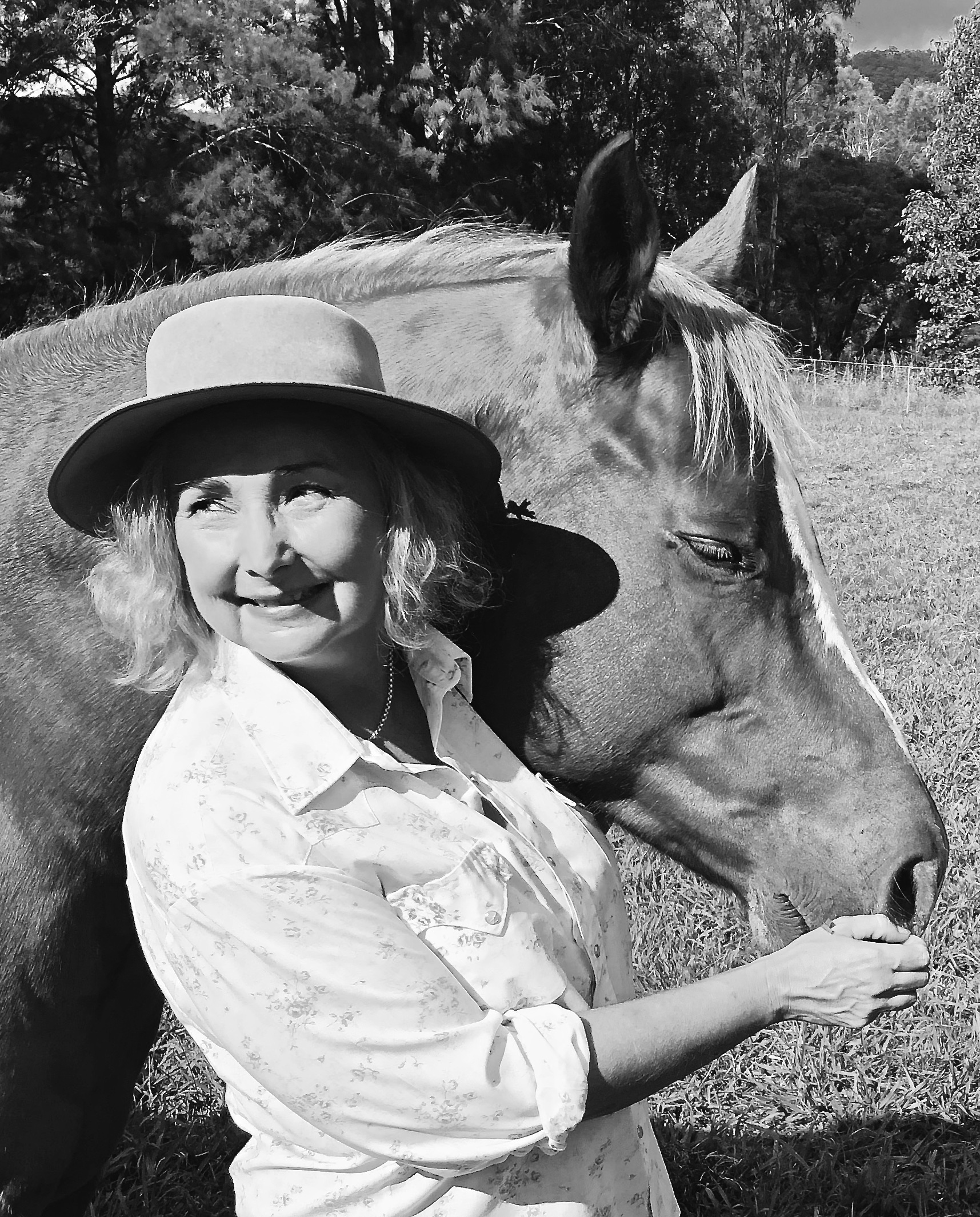 "Linda Bracken - GAICD - Linda Bracken with one of her horses, ""Bluey"", a solid Paint Horse"
