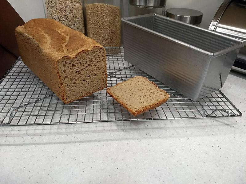 gluten-free yeast bread sliced open alongside KAF pan