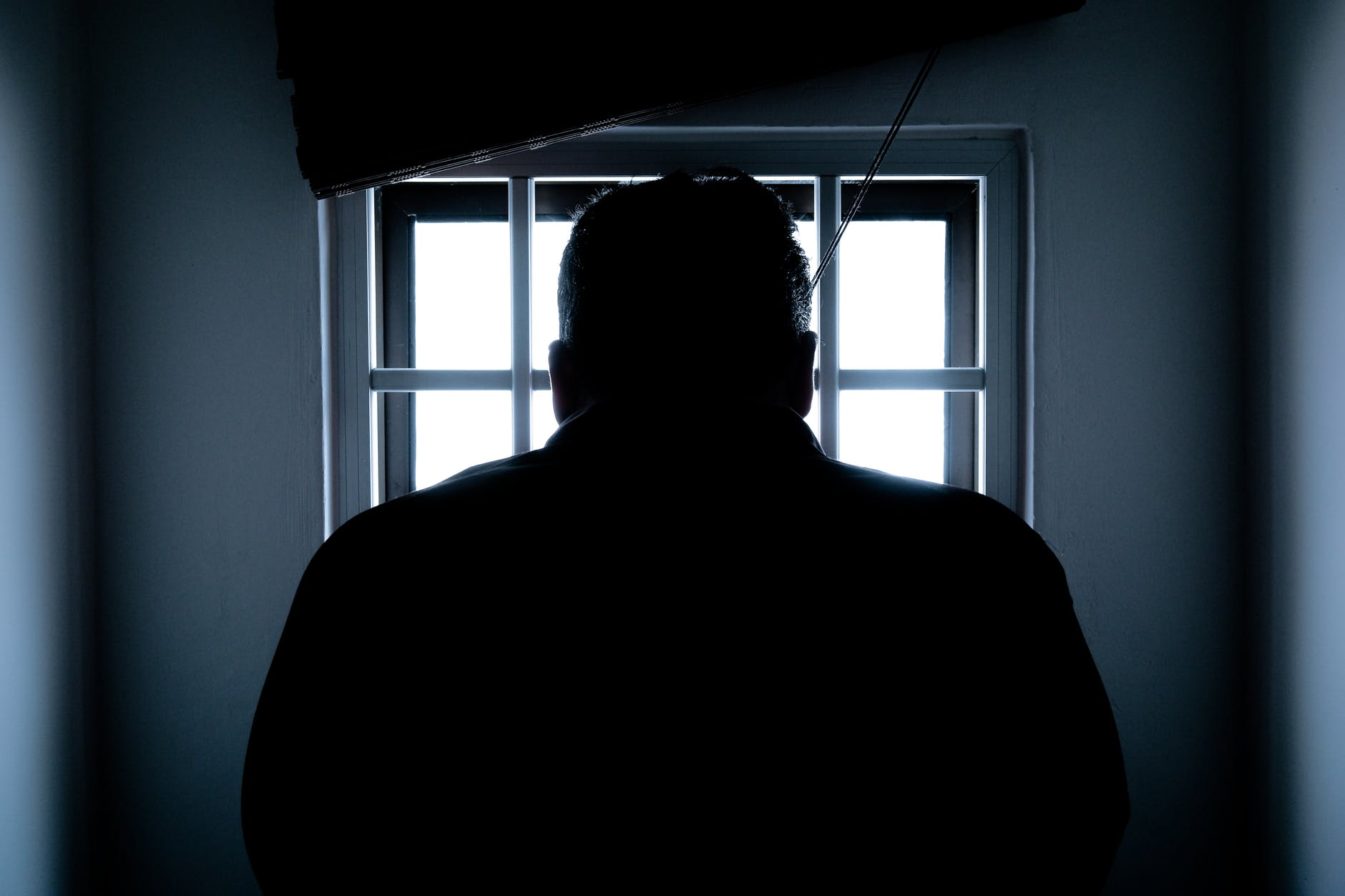 silhouette of a man in window