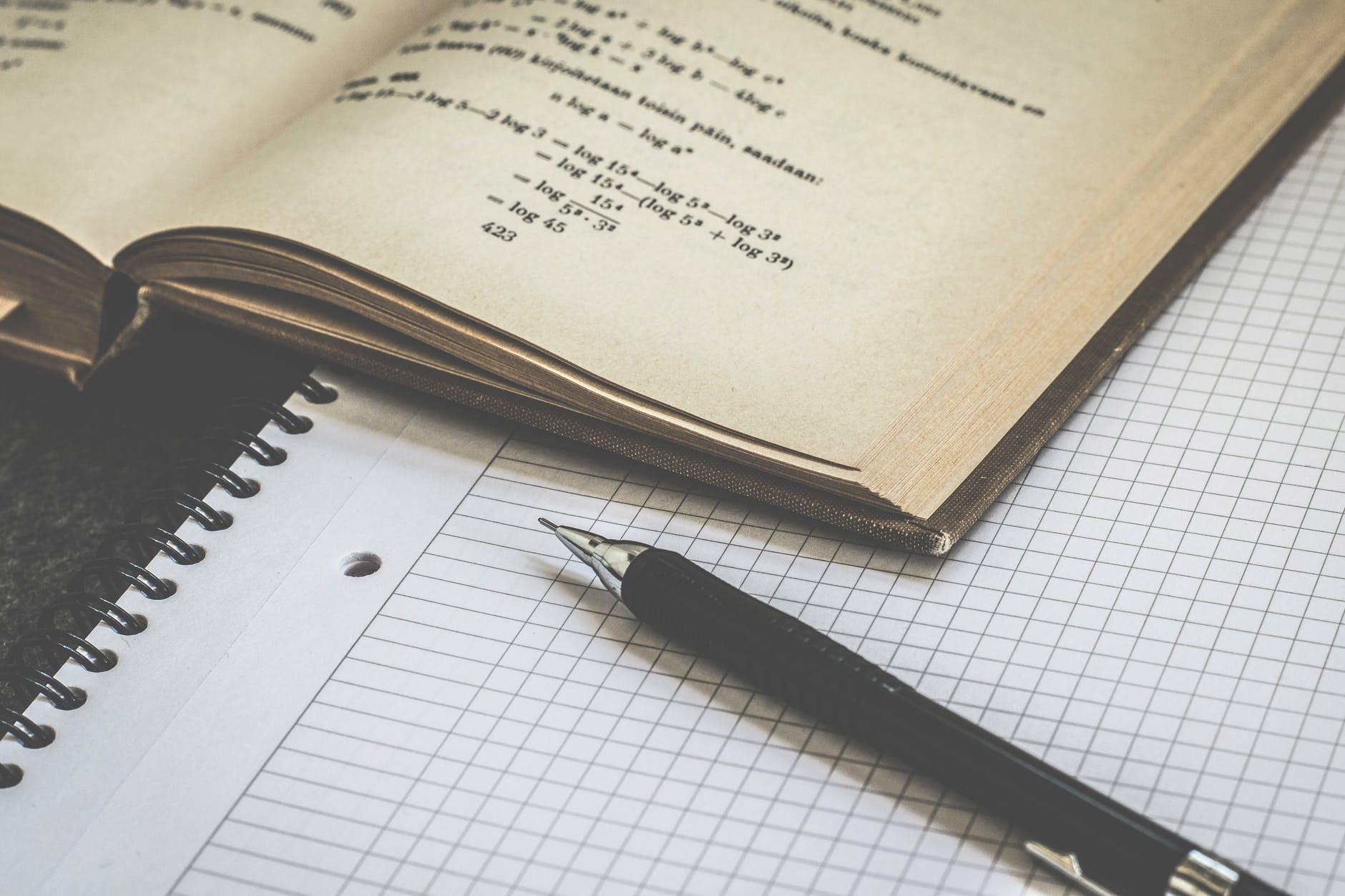 black click pen on white paper