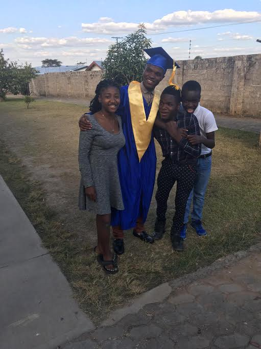 Waddington celebrates his graduation with good friend Mattea and his brothers Shepherd and Innocent.