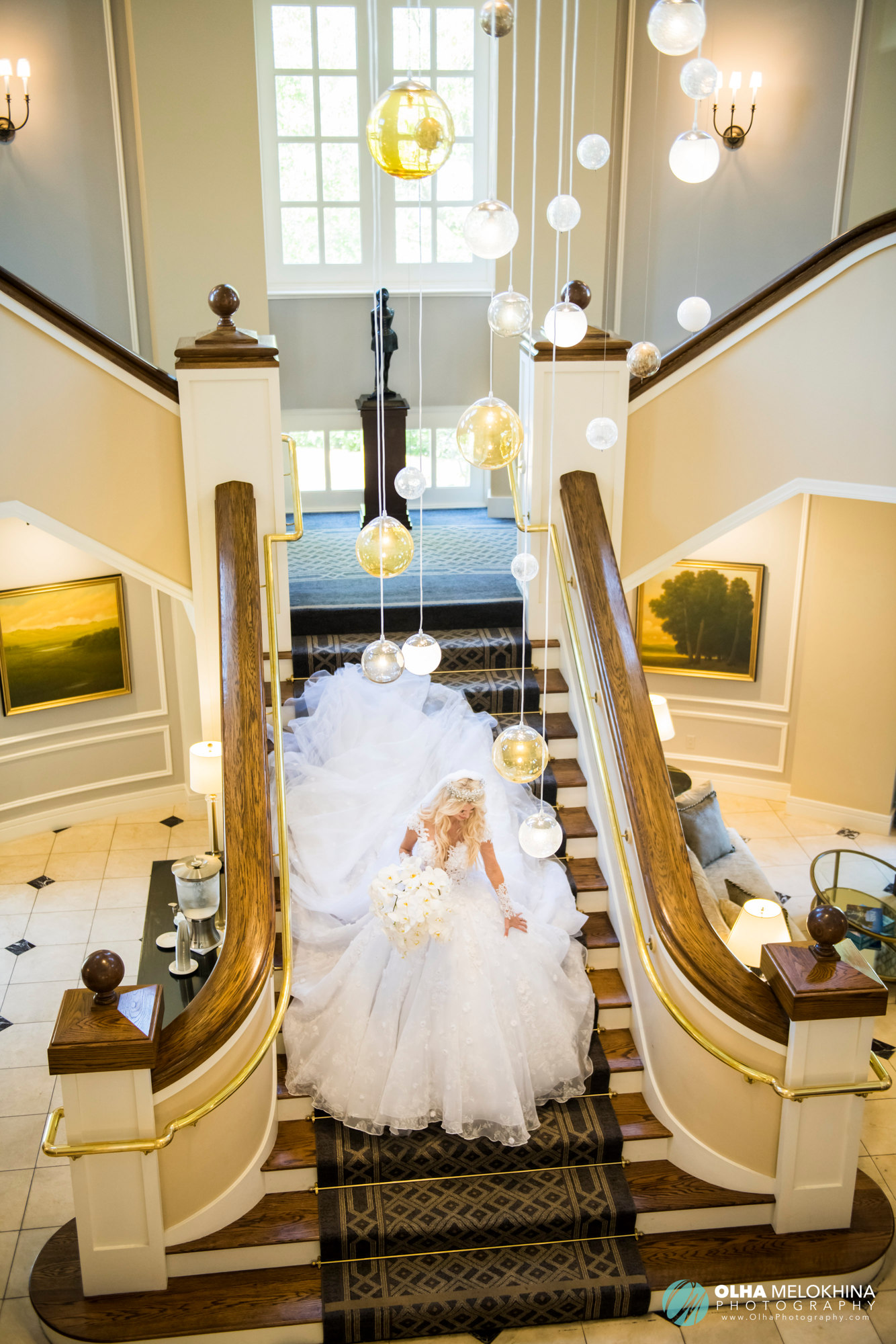 The bride making her way downstairs to take a glimpse at the setup for her big day.