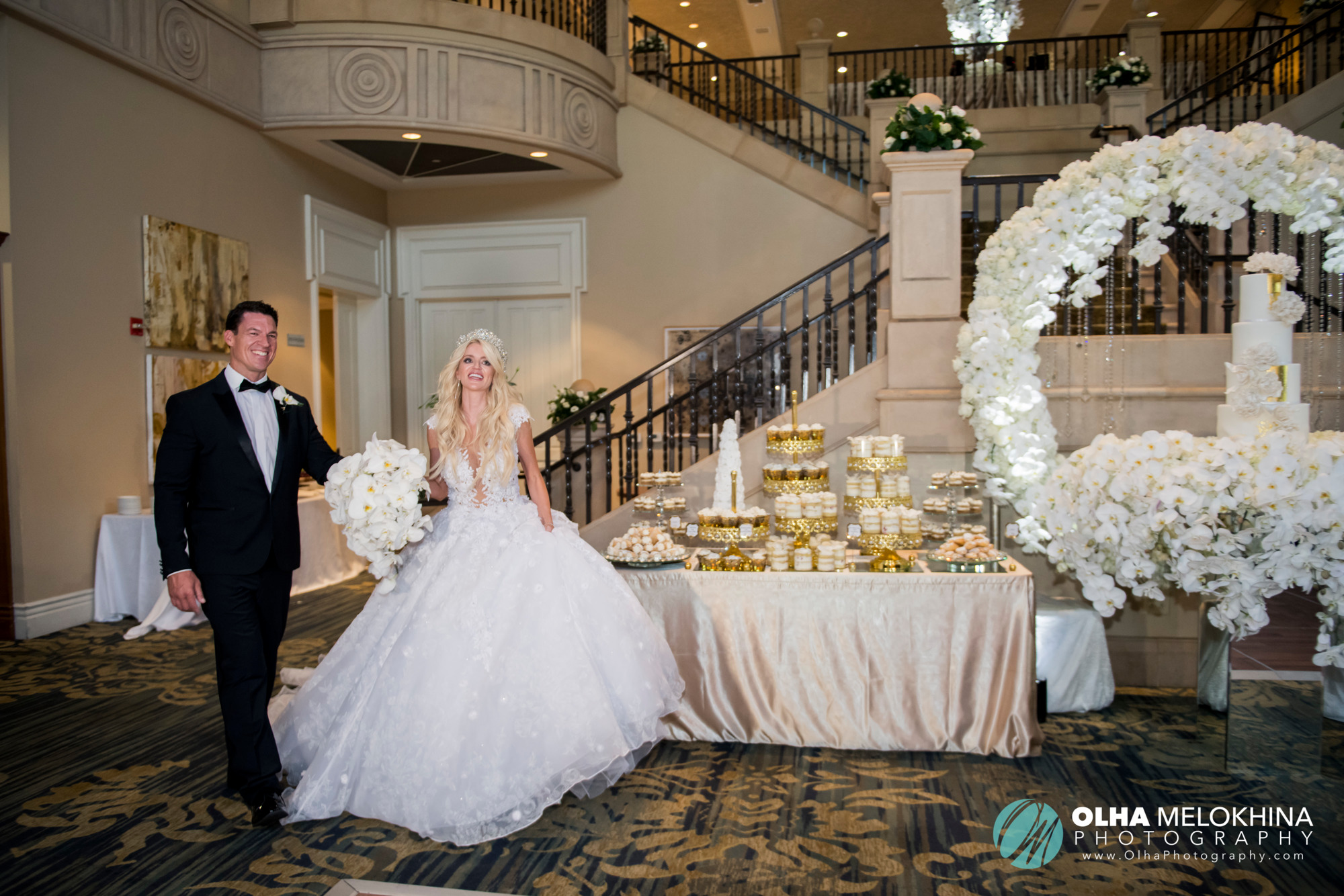 """Kevin & Jaqueline take the stairs down as the guests watch. Truly a """"goosebumps down your back"""" type of moment."""