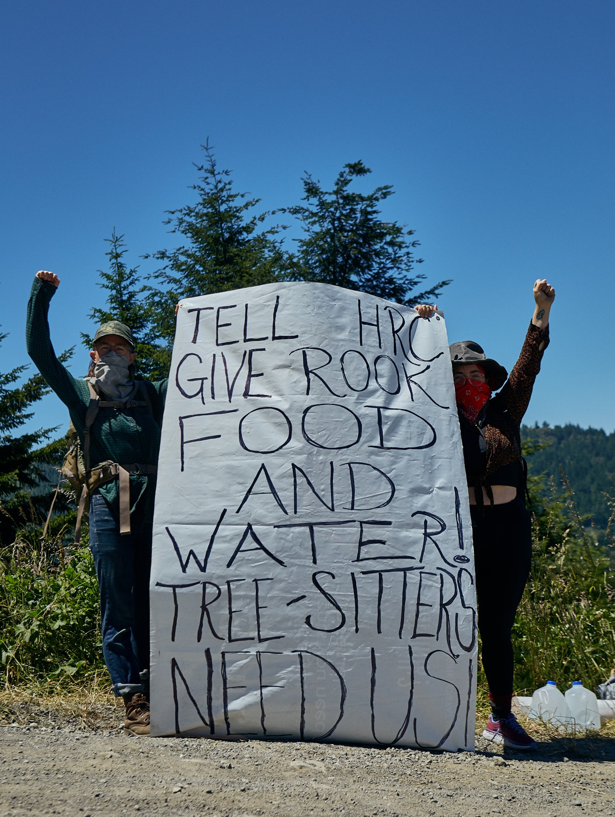 Protesters demonstrate the need for Lear Security to allow more water to the Tree Sitters.
