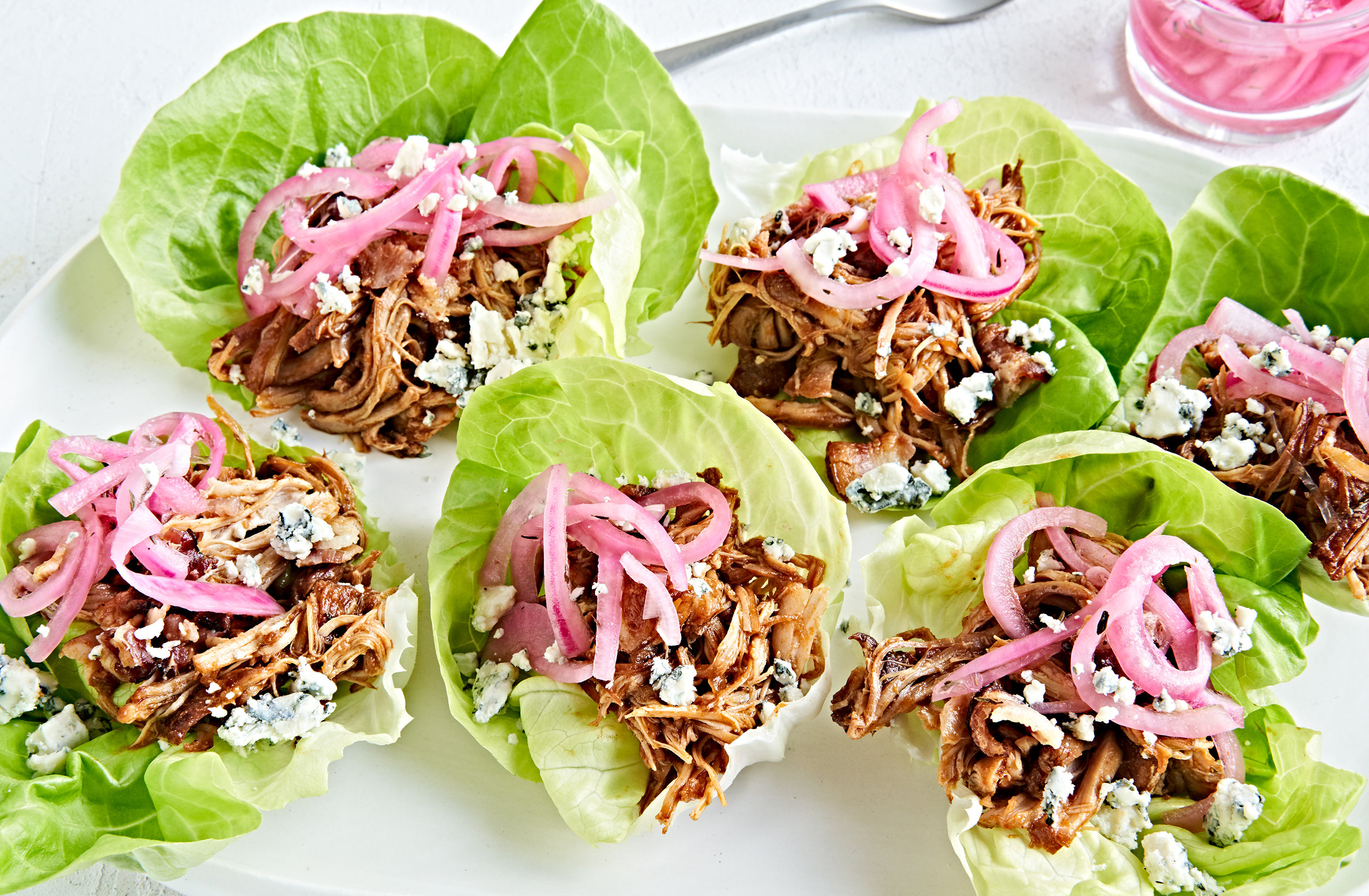 Instant pot pulled chicken in lettuce cups with pickled onions