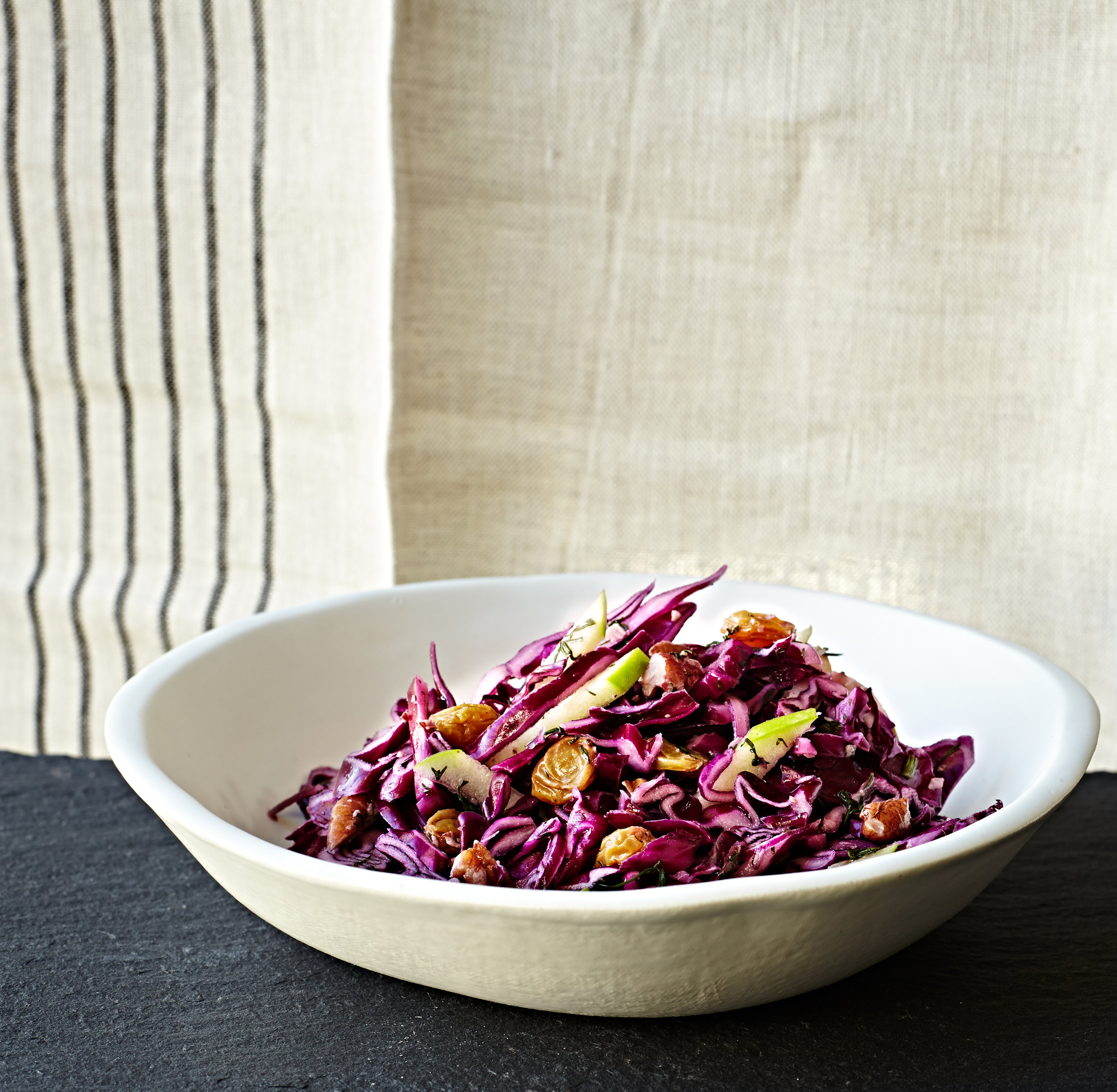 Tangy pickled red cabbage slaw with raisins and apples