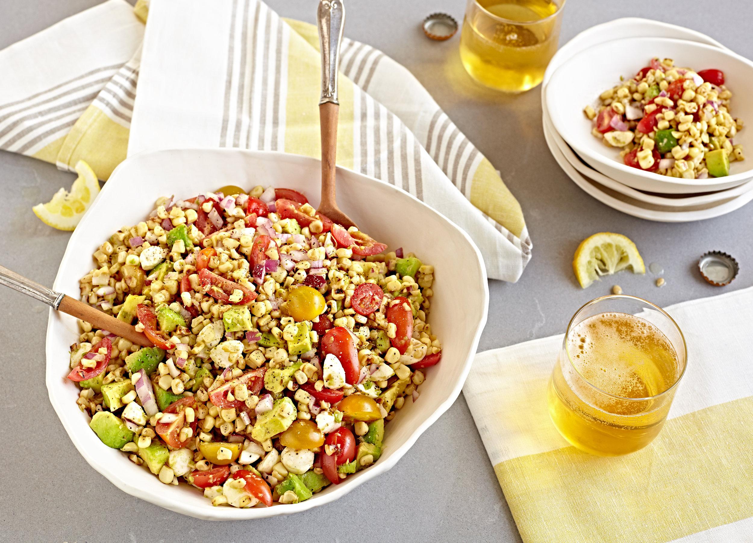 Summer corn salad with fresh avocado tomatoes and mozzarella