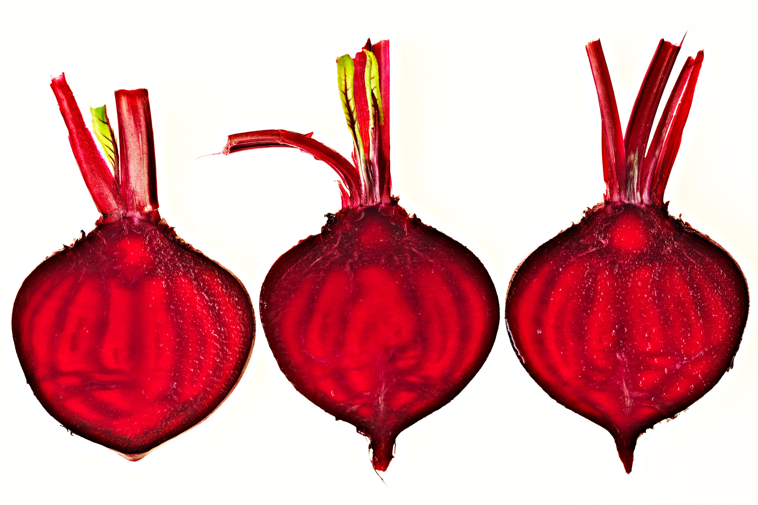 Overhead shot of sliced red beets on white