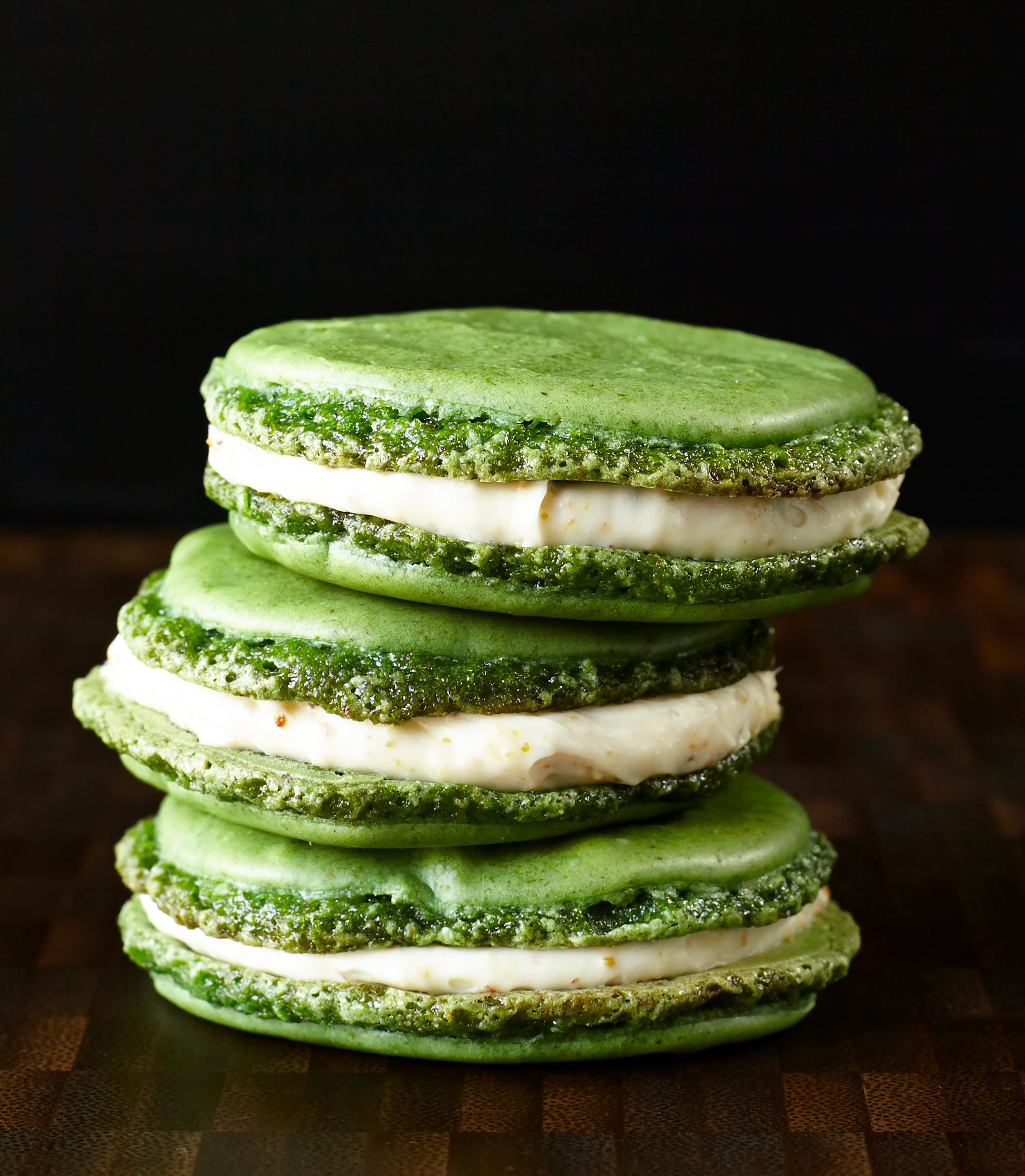 Stacked large pistachio macarons with cream cheese filling
