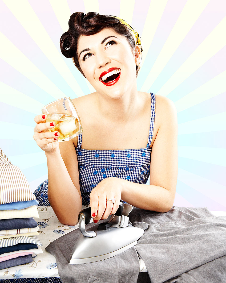1950s housewife ironing men's shirt and drinking liquor