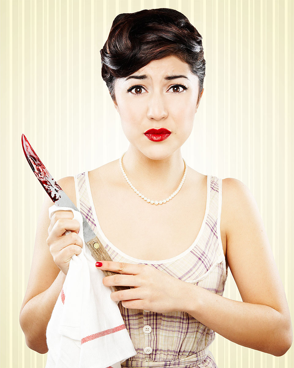 1950s house wife with bloody knife