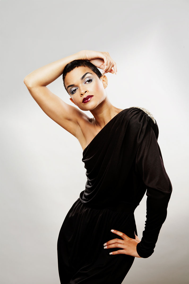 Mixed race model with 80s hair, clothes, and makeup