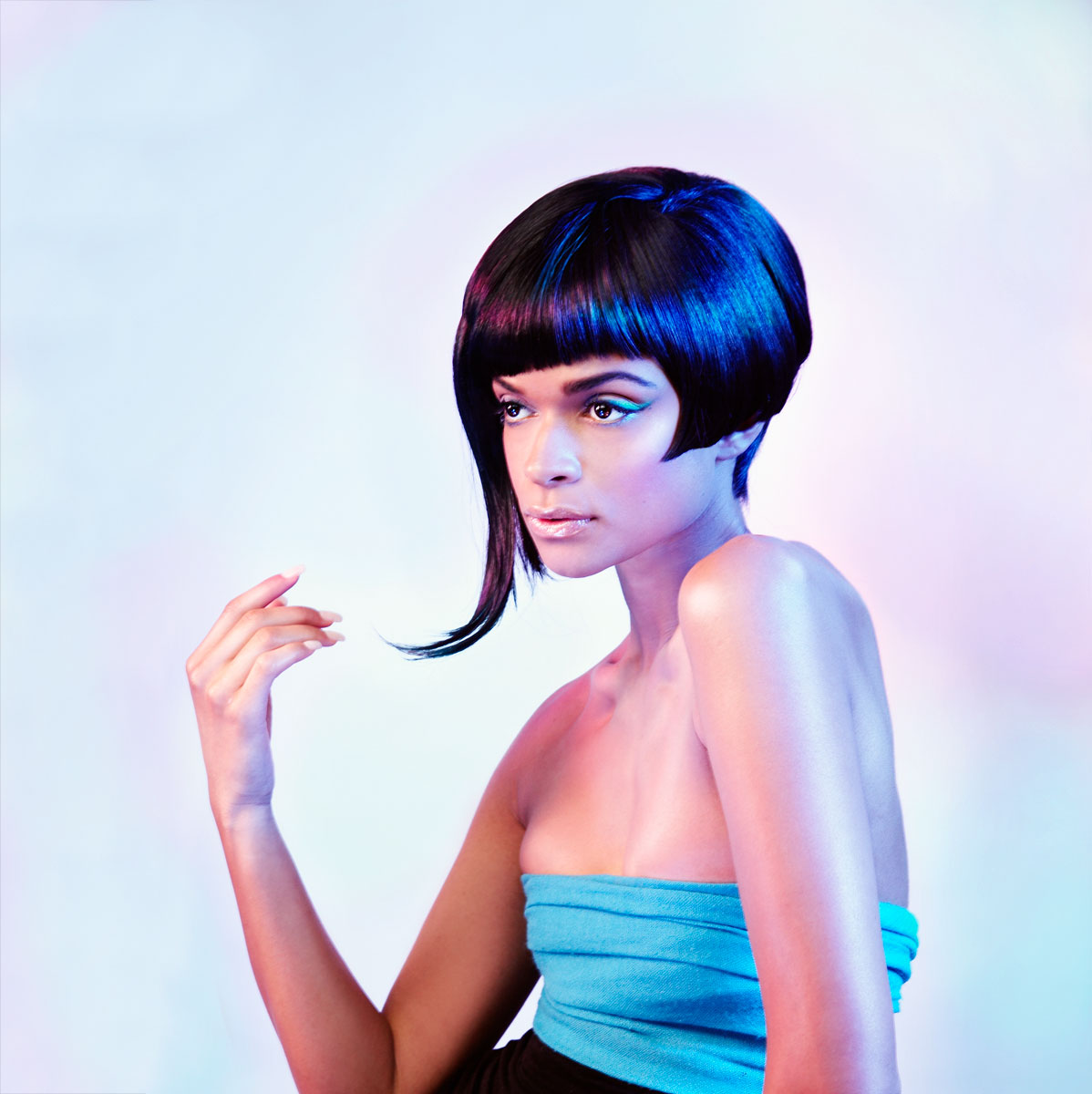 Mixed race model with 60s hair and makeup