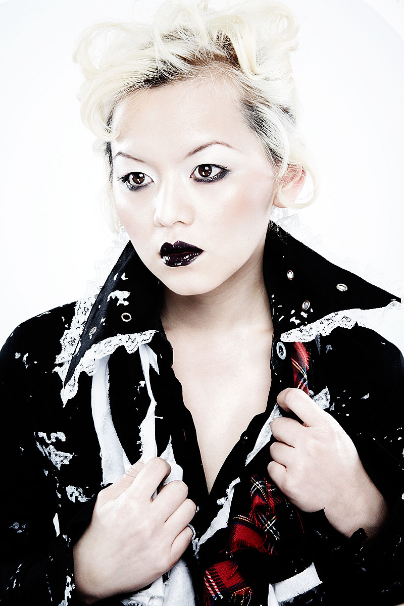 Grunge asian young woman with black lipstick