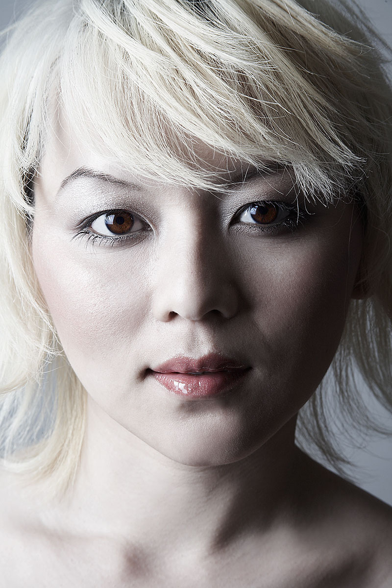 Portrait of fresh-faced young asian woman