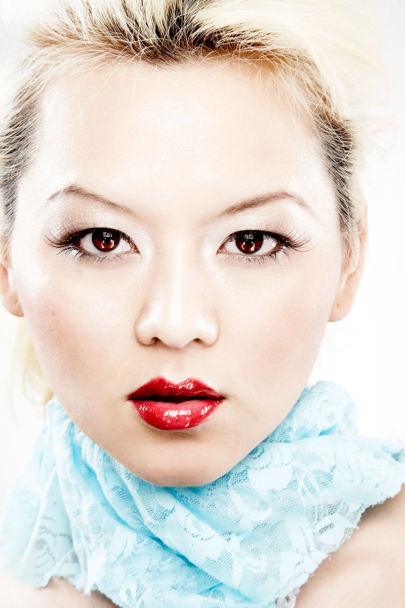 Portrait young asian woman in red lipstick with glowing skin
