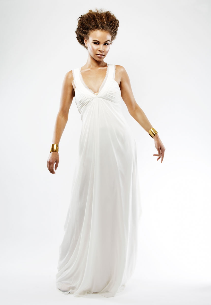 Beautiful, natural black woman in white gown