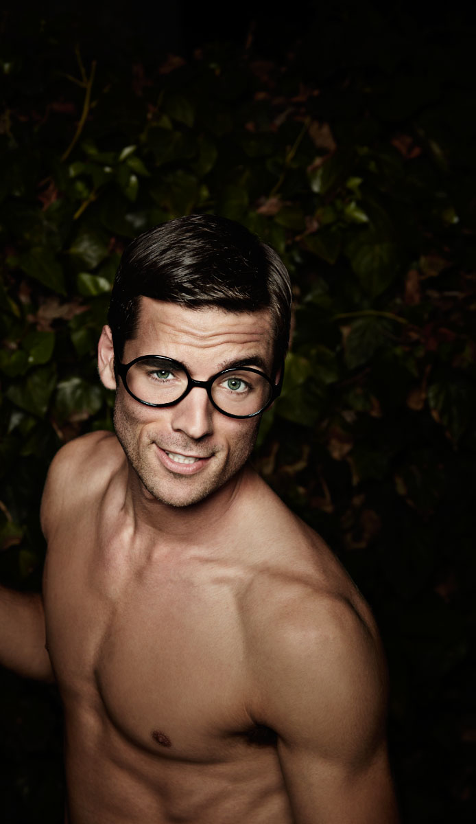 Shirtless fit young man with glasses