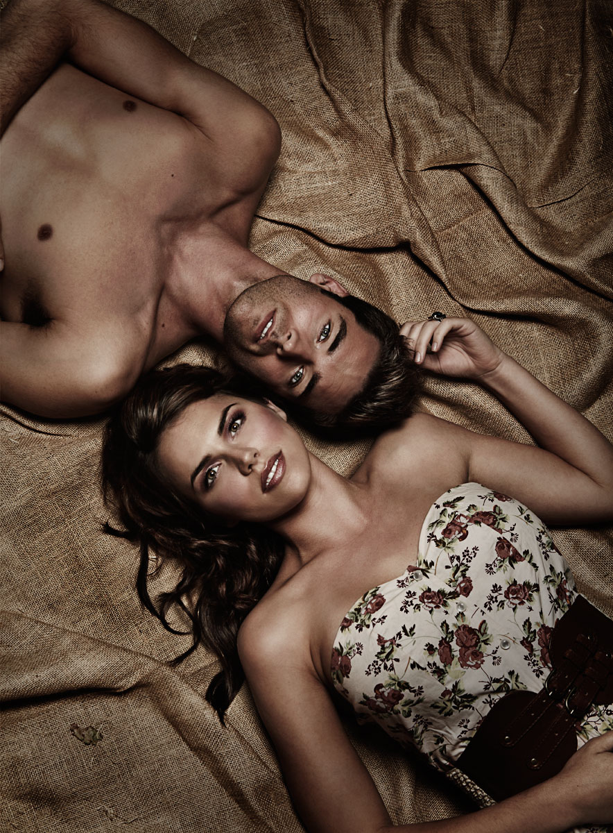 Young caucasian couple laying on blanket outdoors in dark