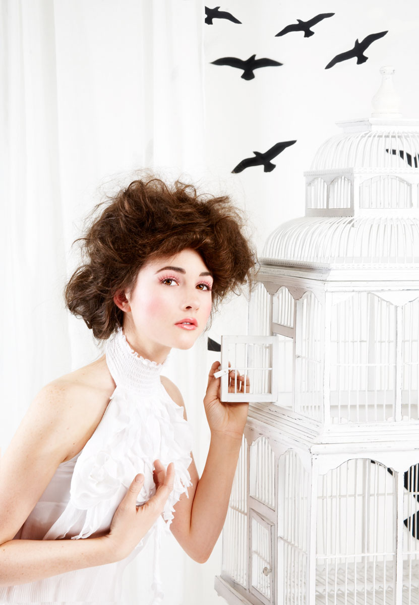 Young woman in fashion birds scene