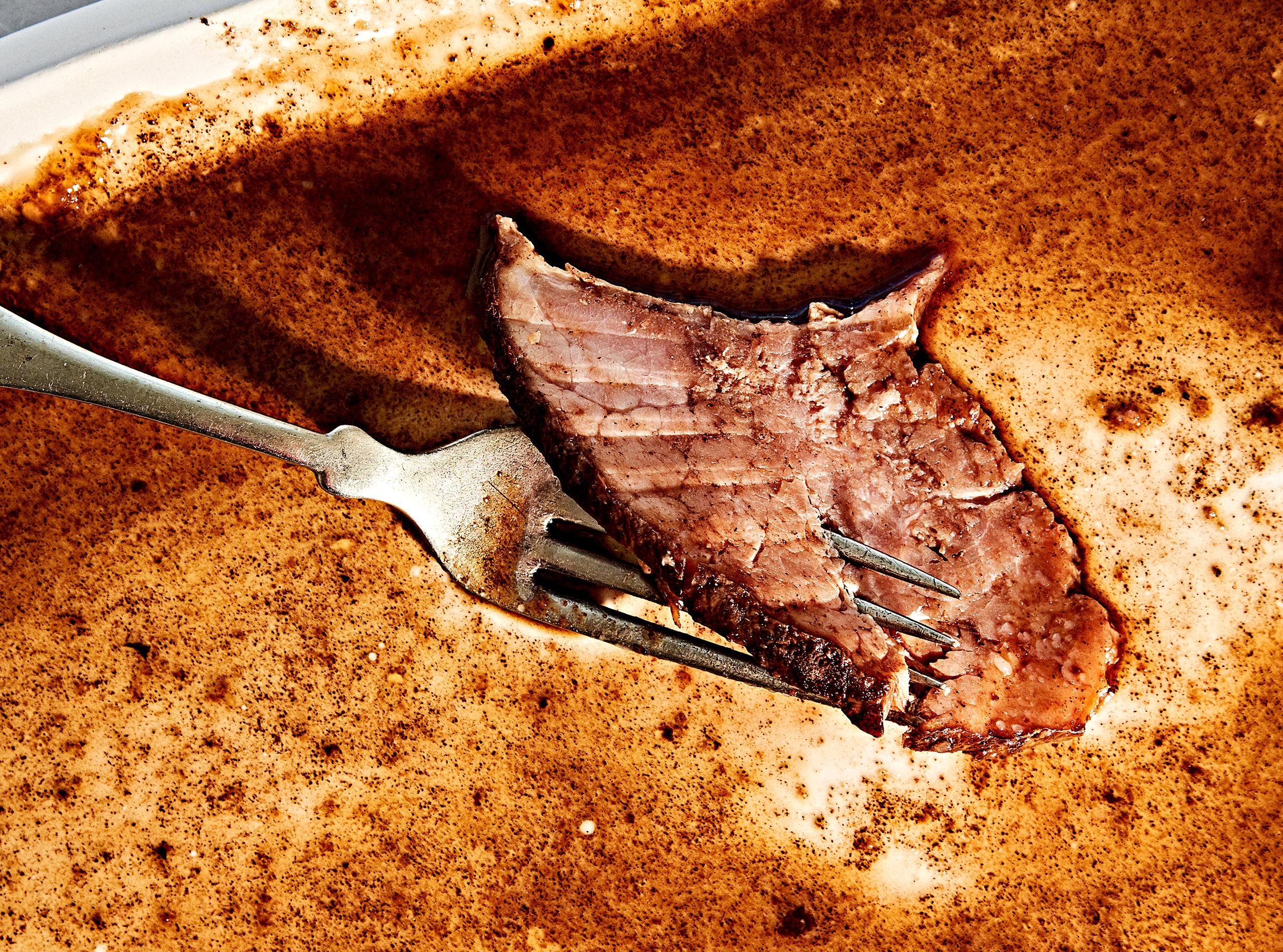 Close up glazed spiral ham on fork