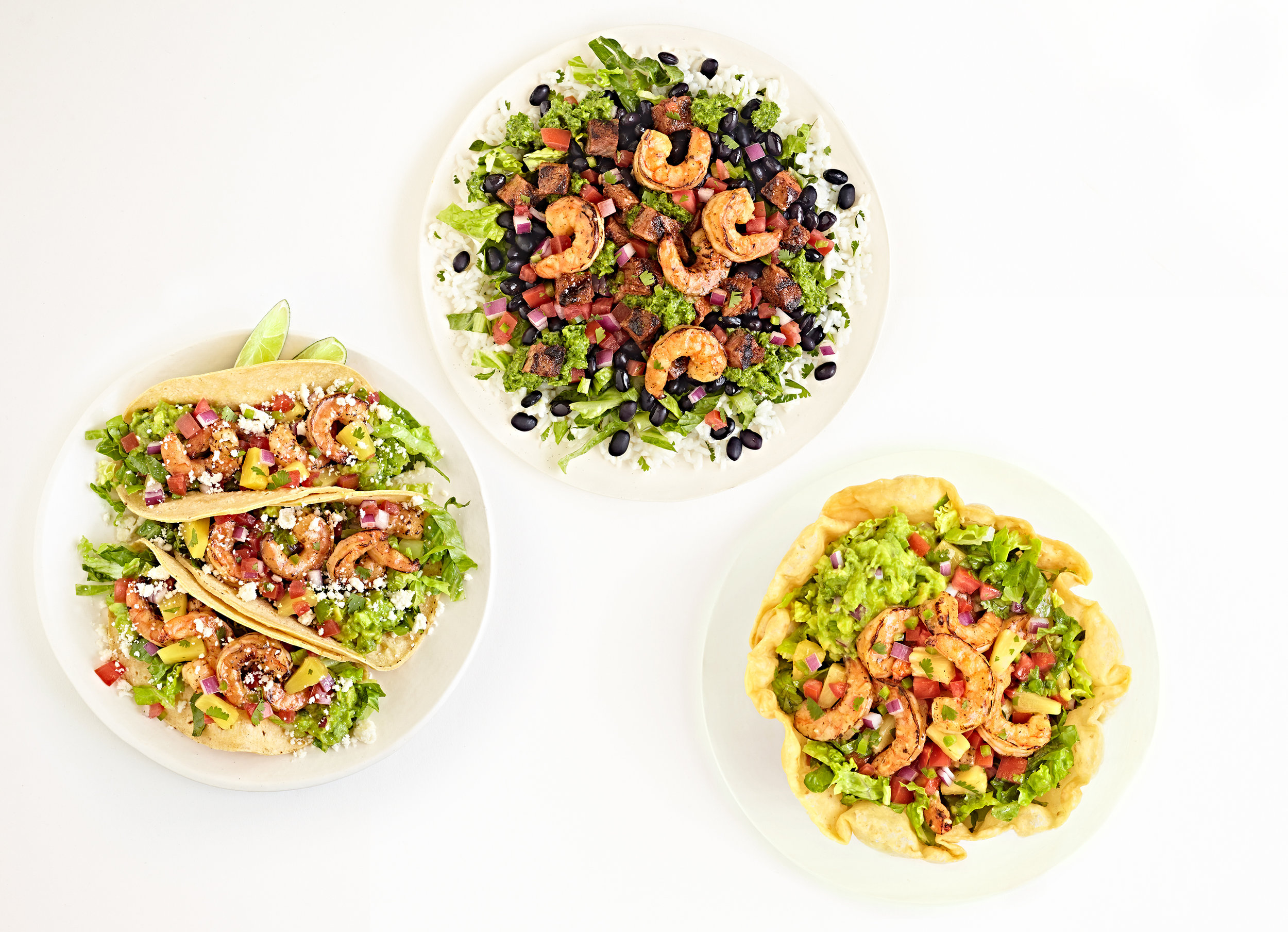 Qdoba mexican food bowls on white