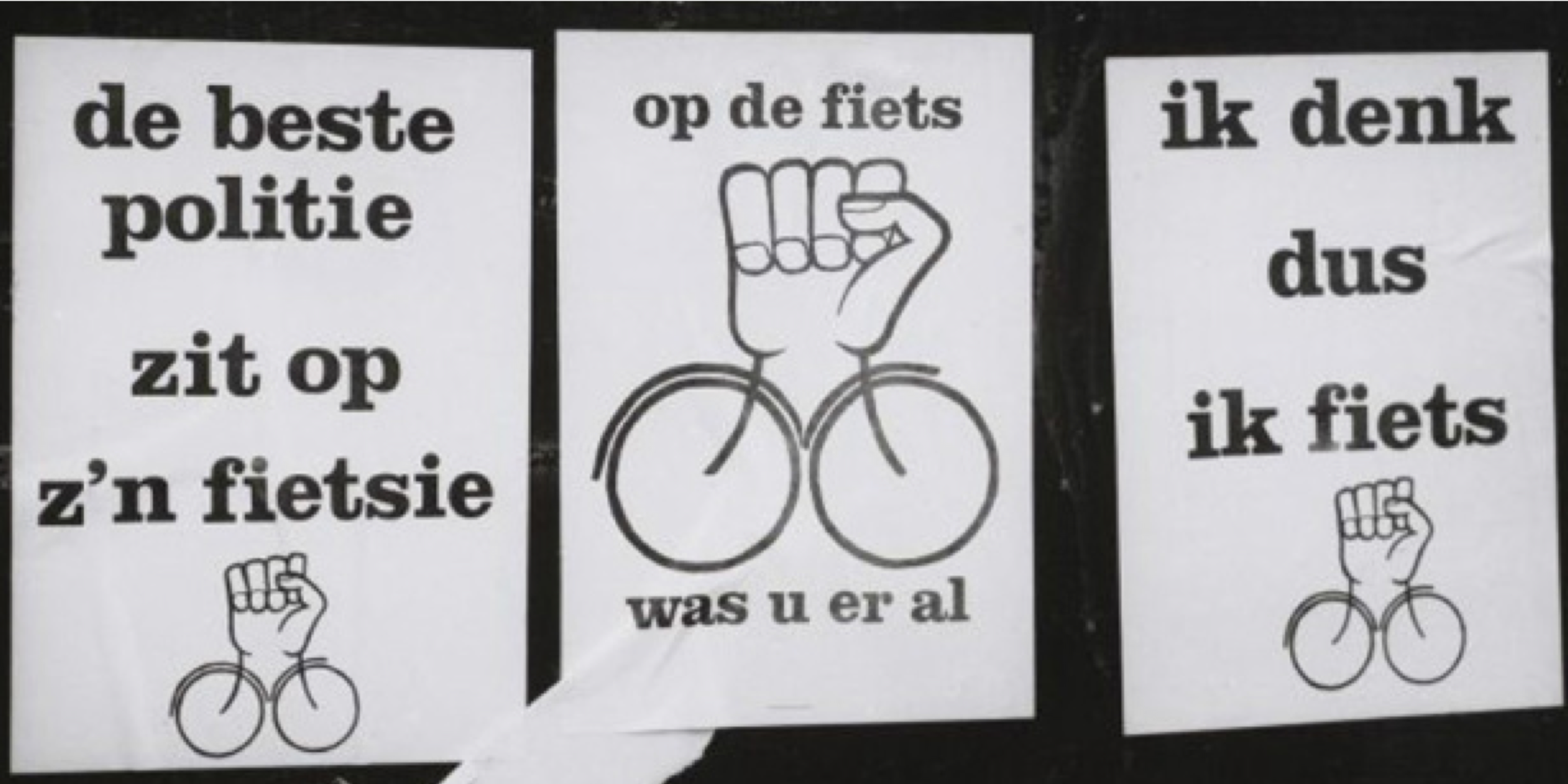 "Protest signs from the awareness campaign:  ""The best police is on his bike,"" ""on the bike, you were already,"" ""I think so, I bike."""