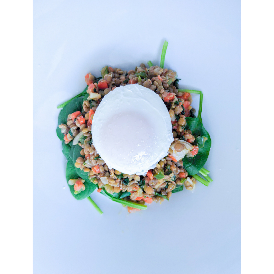 Simple lentil salad served on greens with a poached egg. Pour additio