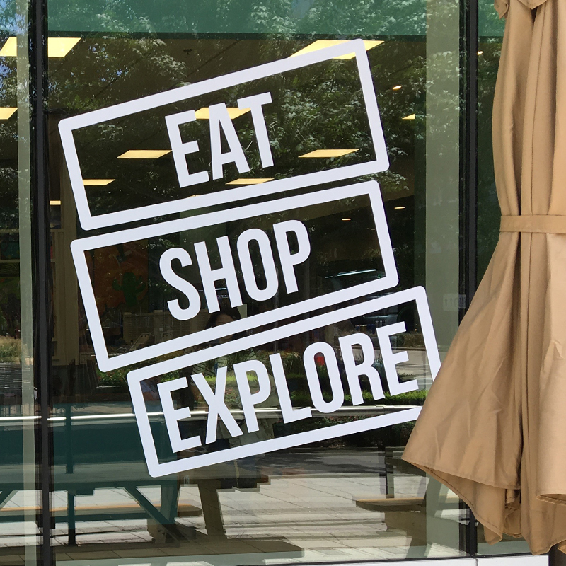 Eat Shop Explore Sign