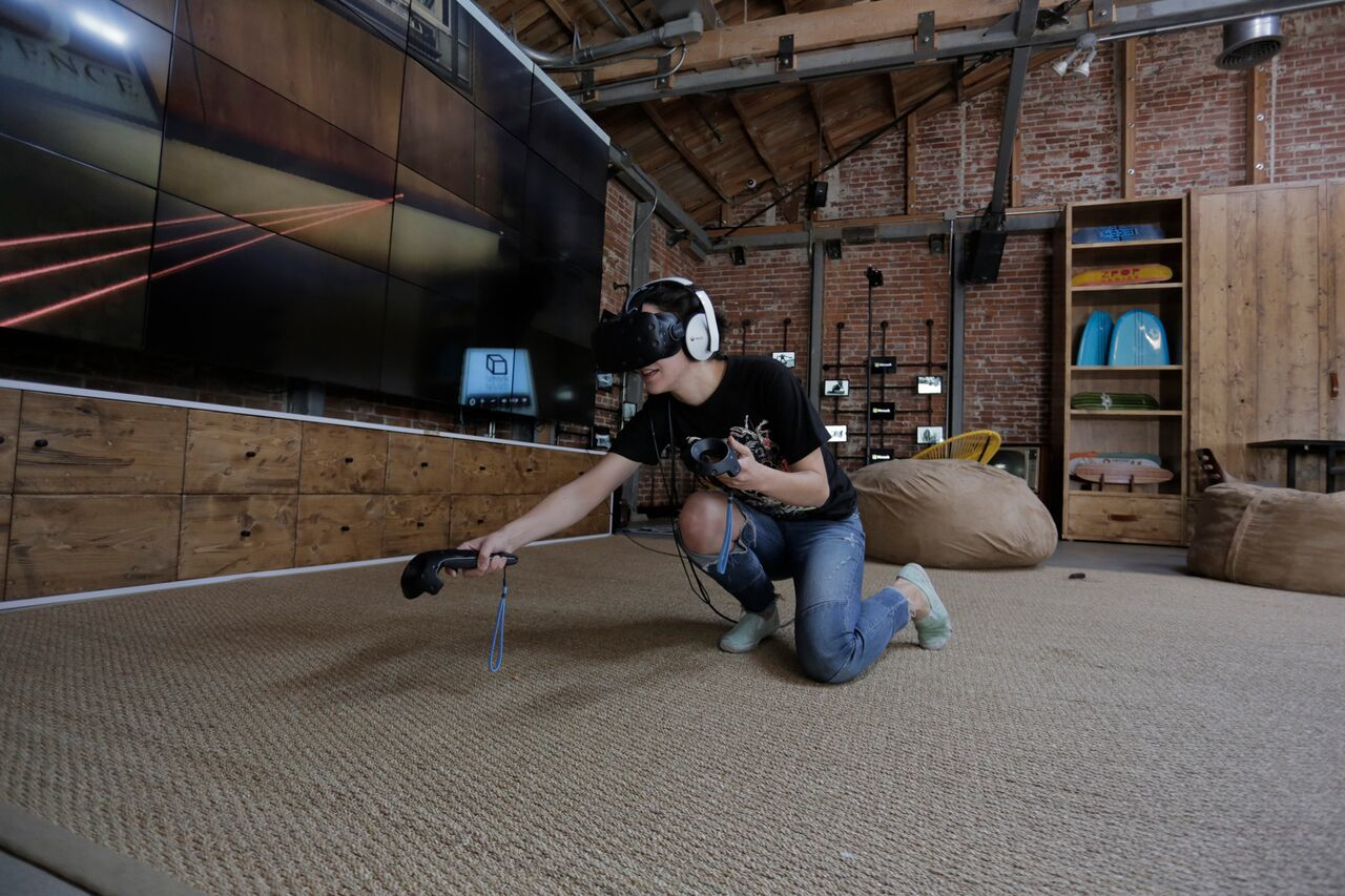 A brave VR explorer tries to escape from the deadly Belko VR: An Escape Room Experiment at the Microsoft Lounge in Venice, CA