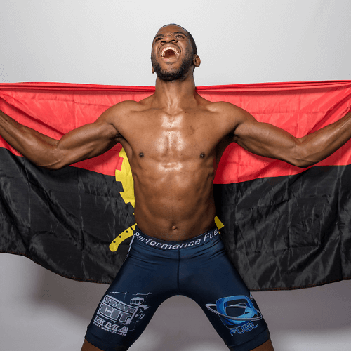 Marino Cutendana poses with the flag of Angola. He has faced many challenges throughout his career, toughest of which being the loss of his father. [CREDIT:  EFC Worldwide ]