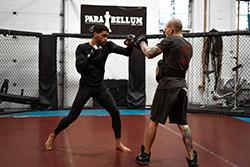 Kyran trains striking techniques with coach Lyndon Whitlock at Para Bellum MMA.(Credit: Patrick Duffy)