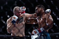 Kyran Cameron vs. Kyle Blinkhorn at BTC 7: Annihilation. Kyran won by overwhelming his opponent with a flurry of punches in the first round. (Credit: Patrick Duffy)