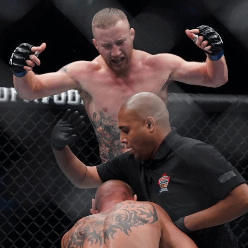"Justin ""The Highlight"" Gaethje (top) expresses his disappointment over referee Jerin Valel's late stoppage following his win over Donald ""Cowboy"" Cerrone. [CREDIT: USA TODAY Sports]"
