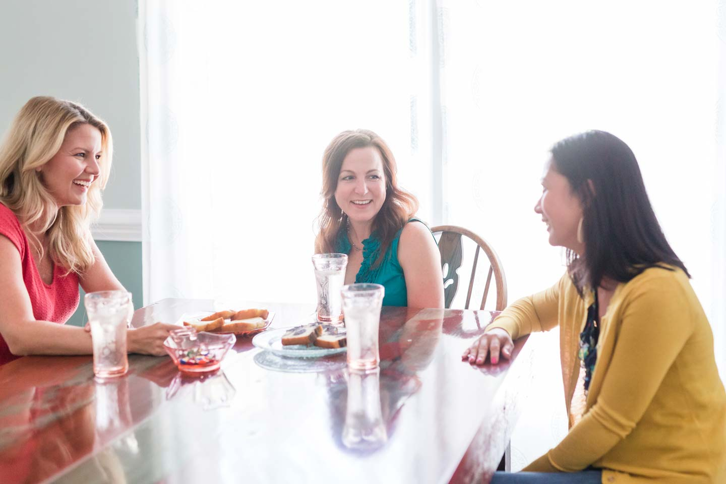 Melissa Bell, a speaker for Women's Christian events, talking with group of women