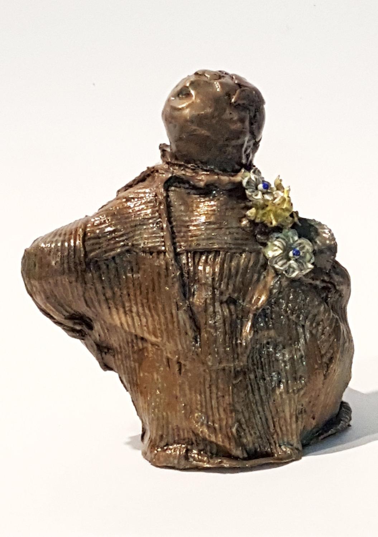 bronze child w flowers 1 a front.jpg